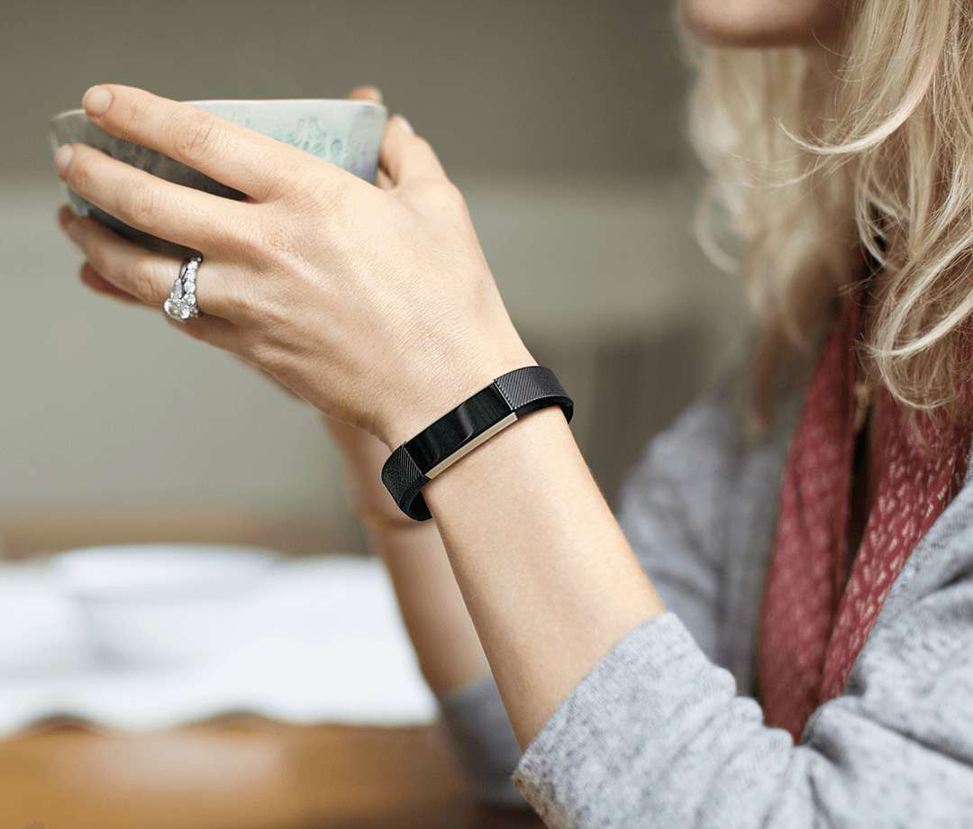Woman wearing Fitbit Alta
